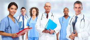 Group of medical doctors over health care clinic background.